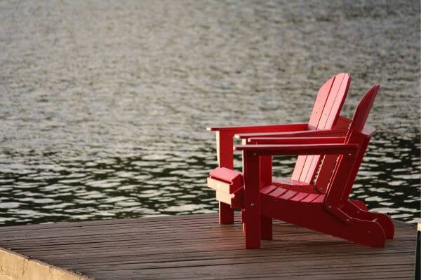 Picture of red chairs to imagine your life as a financially sound person.
