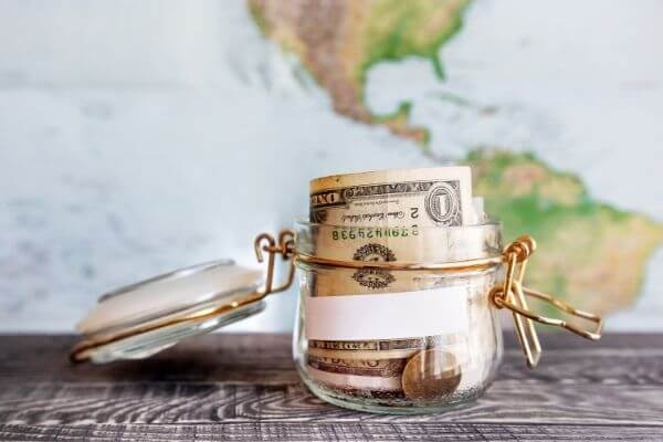 Picture of vacation fund jar to help you save money for travel.