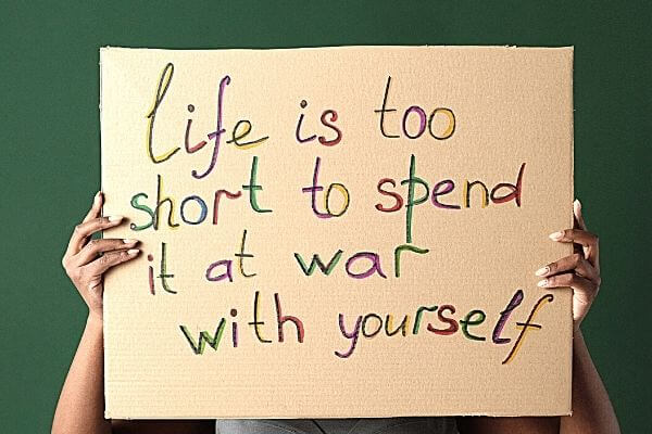 """Picture of a sign saying """"Life is too short to spend it at war with yourself"""" for the 30 day productivity challenge."""
