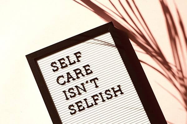Picture of lettering for a 30 day self care challenge saying self care isn't selfish.