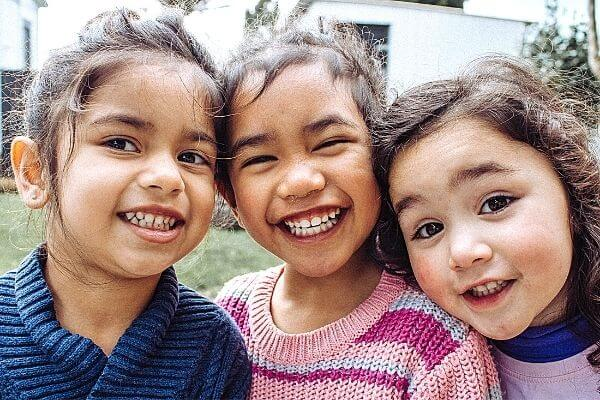 Picture of smiling kids participating in their 30 day challenge for kids.