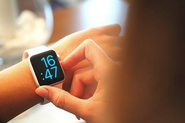 Picture of a digital watch to show time to save 5000 in 6 months.